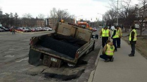 A road repair truck is eaten by a pothole in East Lansing. Was Freud an engineer?